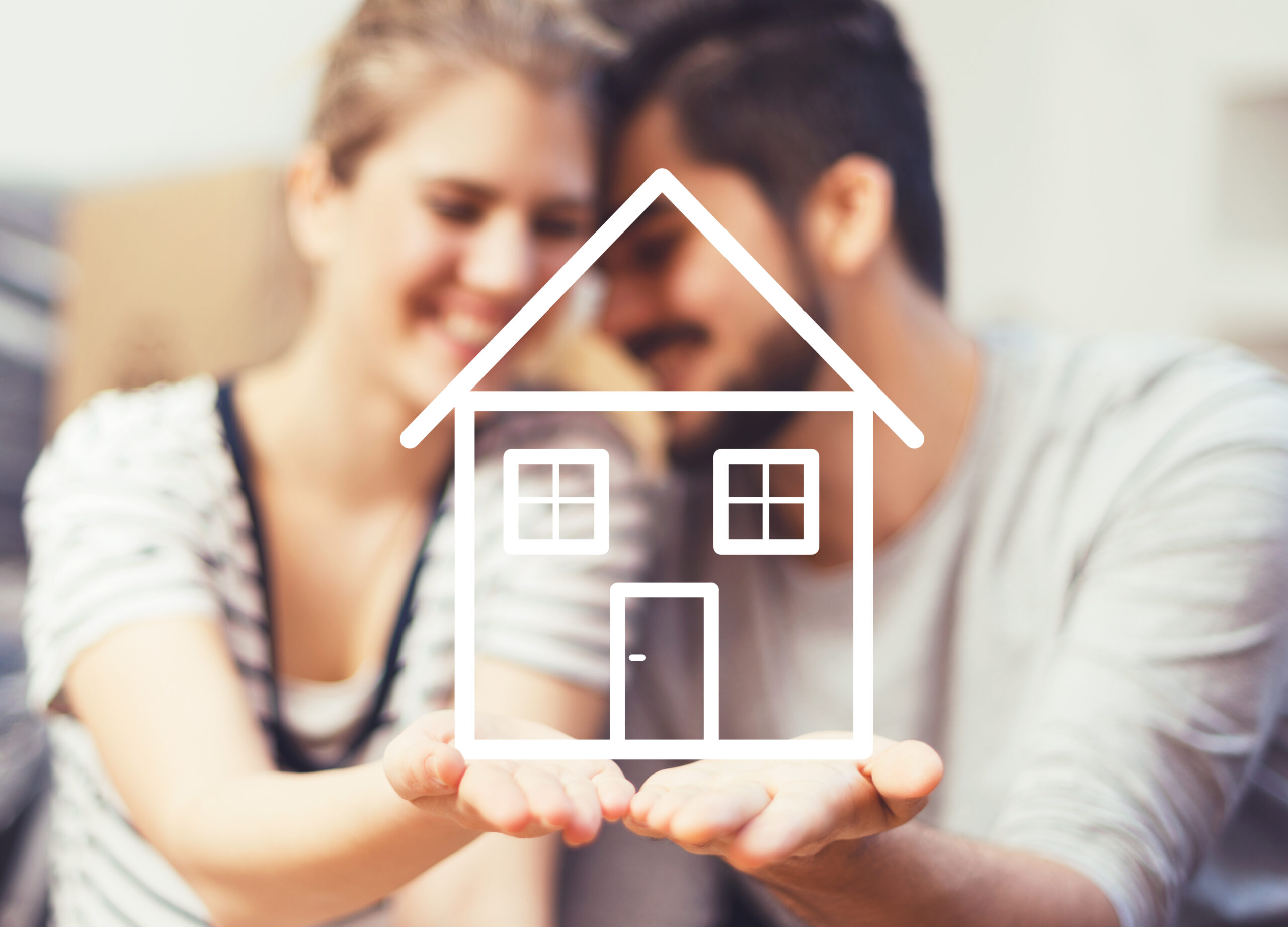 faded couple holding drawing of new home in hands