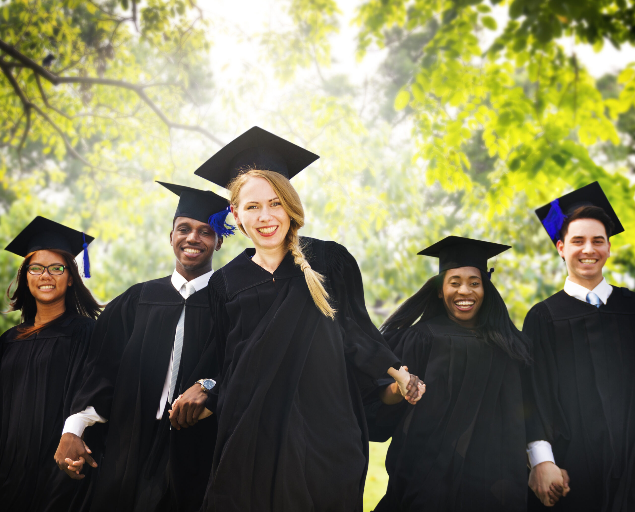 Happy Graduating Students in Caps and Gowns